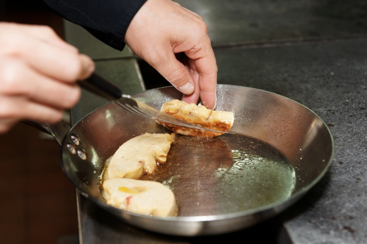 Chef is frying foie gras on pan